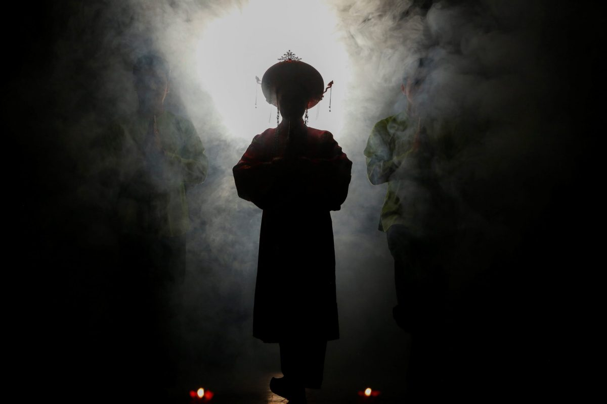 Medium An Chinh walks through smoke during a Hau Dong performance at the Viet Theater in Hanoi. Photo: Reuters/Kham
