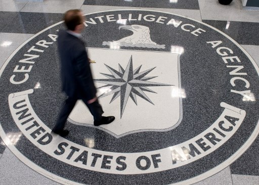 A man crosses the Central Intelligence Agency (CIA) seal in the lobby of CIA Headquarters in Langley, Virginia. Photo: AFP/Saul Loeb