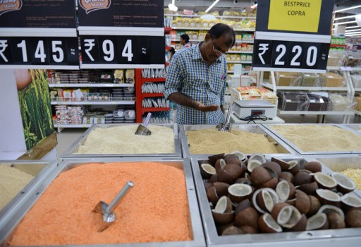 An Indian shopper browses products at a newly-opened supermarket in Hyderabad. Photo: AFP, Noah Seelam