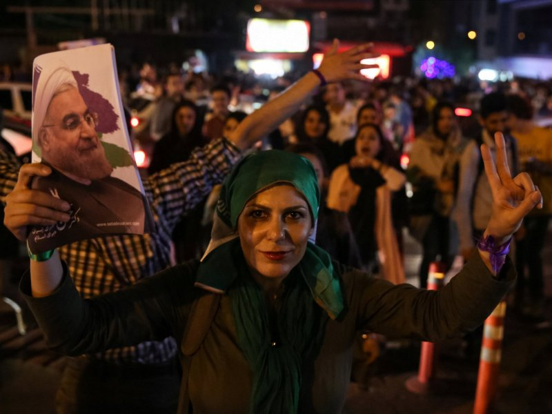 Supporters of Iranian President Hassan Rouhani celebrate his re-election victory in Tehran on May 20, 2017. Photo: TIMA via Reuters