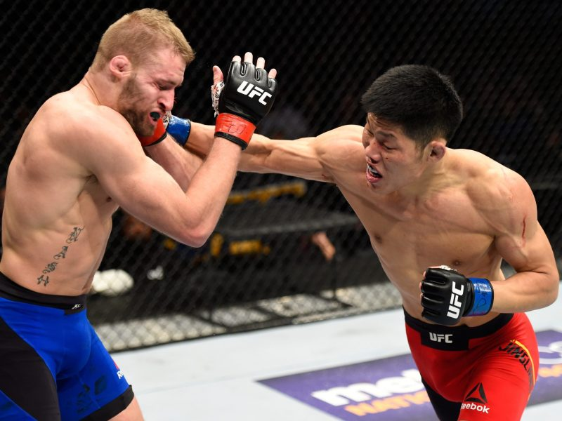 Li Jingliang of China punches America's Bobby Nash in their welterweight bout during the UFC Fight Night event at the Pepsi Center on January 28, 2017, in Denver, Colorado. Photo: Josh Hedges / Zuffa LLC via Getty Images
