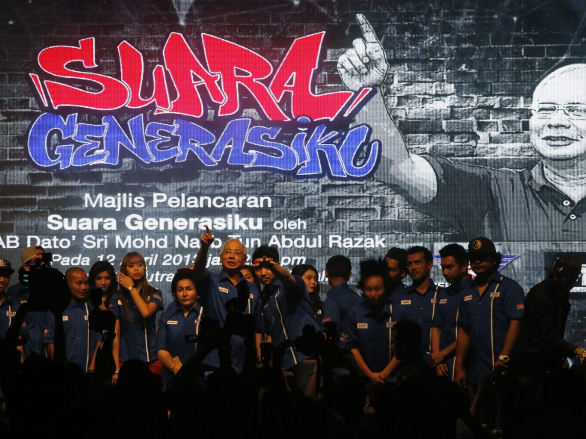 """Malaysia's Prime Minister Najib Razak (C) talks to youngsters after he launched the """"Voices of My Generation"""" youth program in Kuala Lumpur. Young Malaysians are a crucial, potentially decisive, source of support in national elections. Photo: Reuters/Bazuki Muhammad"""
