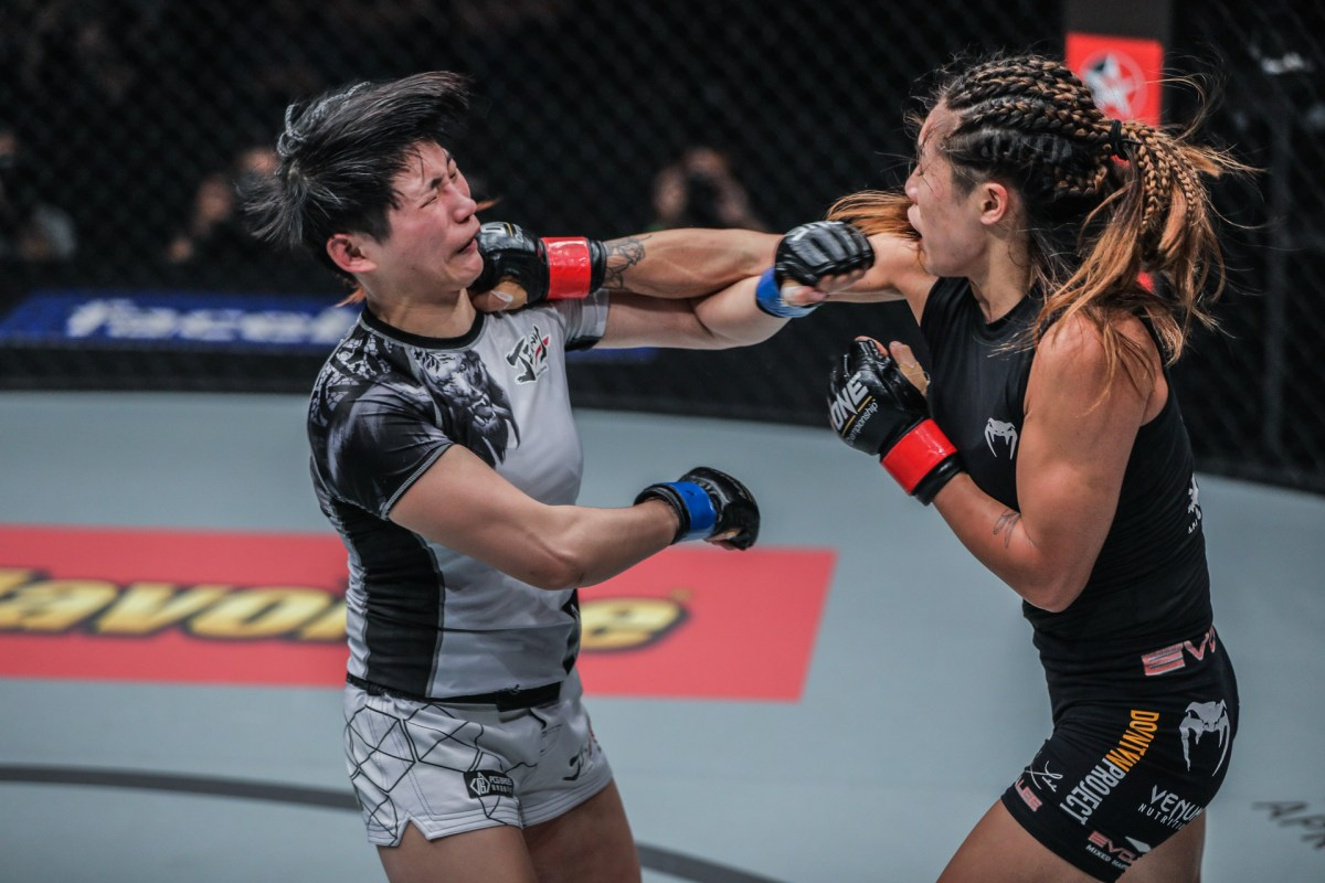Ooof... Angela Lee lands a blow against Jenny Huang in Bangkok. Photo: One Championship