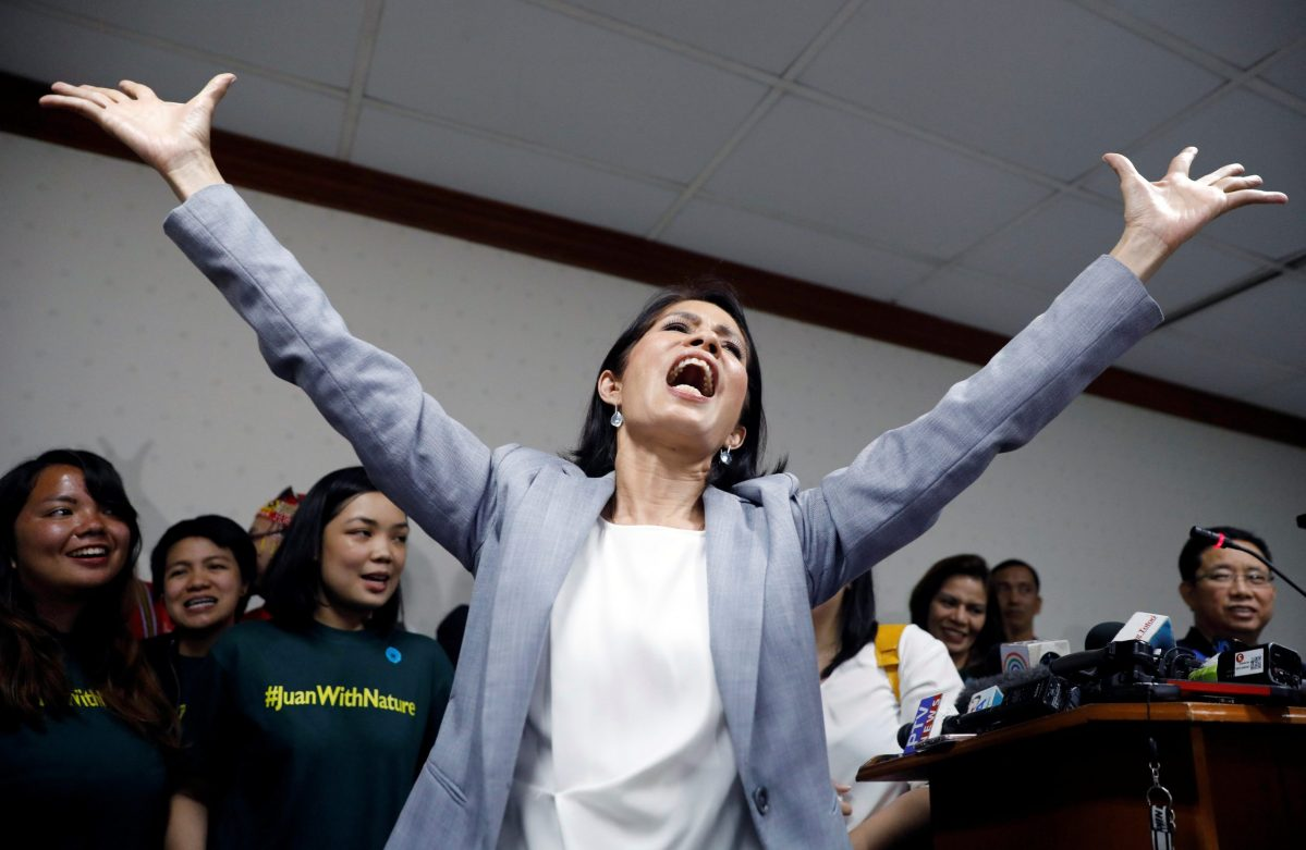 """Philippine Environment Secretary Regina Lopez sings """"I believe I can fly"""" during a news conference shortly after lawmakers rejected her appointment as Environment Secretary, 10 months into her term in office, at the Senate in Manila, Philippines May 3, 2017.  Photo: Reuters/Erik De Castro"""