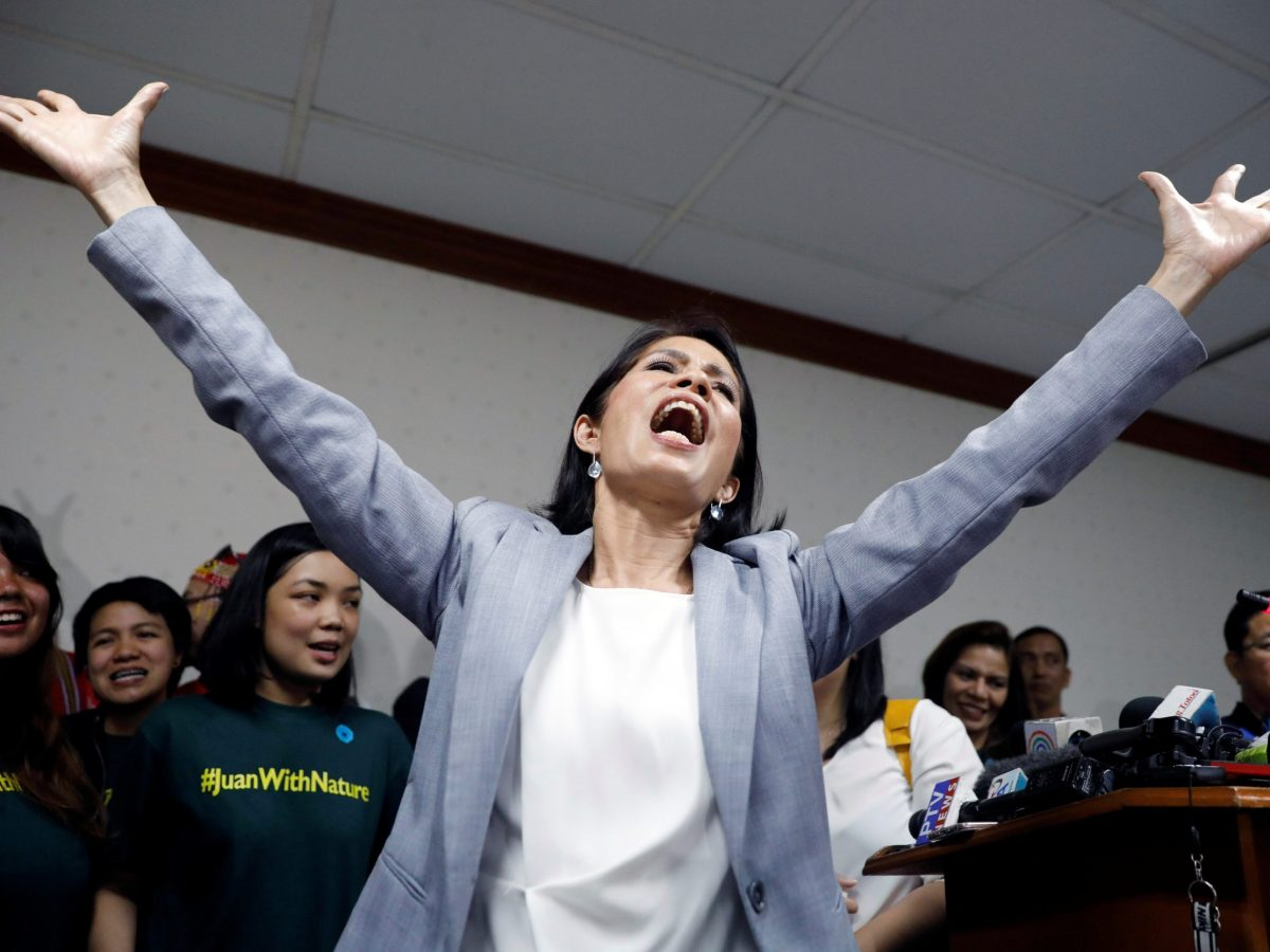 "Philippine Environment Secretary Regina Lopez sings ""I believe I can fly"" during a news conference shortly after lawmakers rejected her appointment as Environment Secretary, 10 months into her term in office, at the Senate in Manila, Philippines May 3, 2017.  Photo: Reuters/Erik De Castro"