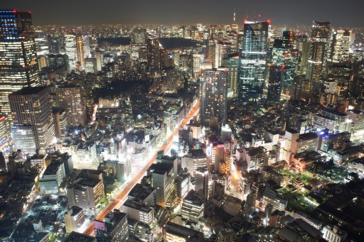 Cityscape view with skyscrapers and city lights at night, Tokyo, Japan. Photo: AFP