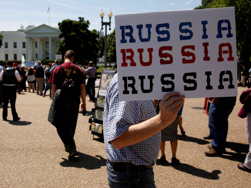 Protesters rally outside the White House on May 10, 2017, against US President Donald Trump's firing of FBI director James Comey.  Photo: Reuters/Jonathan Ernst