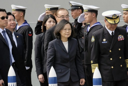 Taiwan President Tsai Ing-wen (C) arrives at the Tsoying navy base in Kaohsiung, southern Taiwan on March 21, 2017.  Taiwan formally launched an ambitious project to build its own submarines as the island faces growing military threats from China as relations deteriorate. Photo: AFP/ Sam Yeh