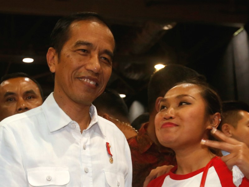 """Indonesian President Joko """"Jokowi"""" Widodo is greeted by Indonesian migrant workers during his arrival in Hong Kong. Photo: Reuters/Bobby Yip"""