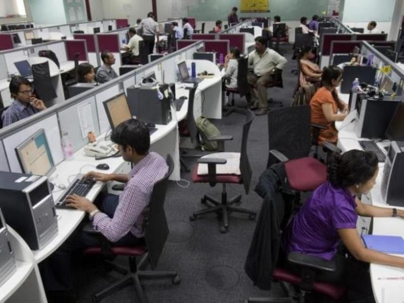 Employees busy themselves at a business process outsourcing unit in Bangalore. Photo: Reuters