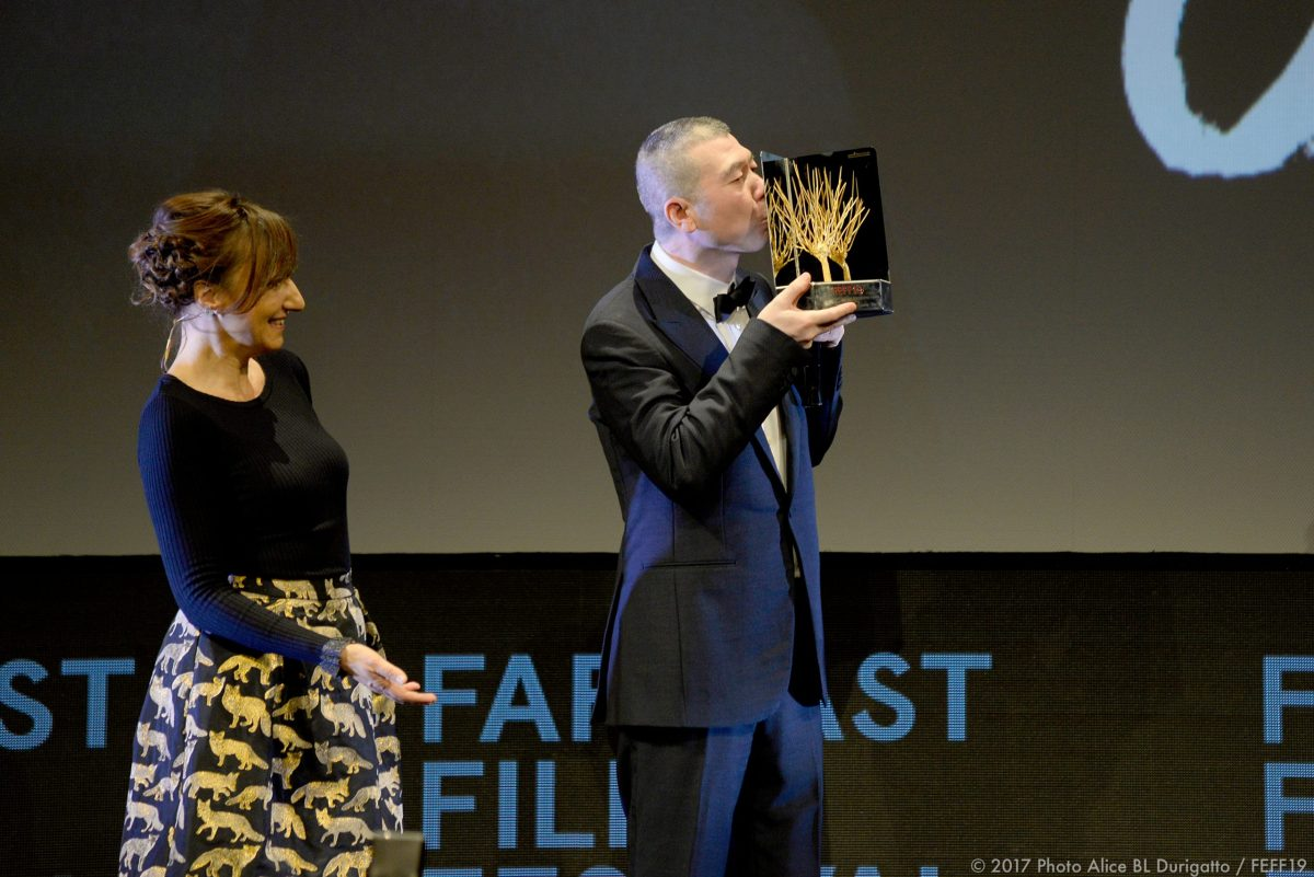 Feng Xiaogang accepts his Golden Mulberry award at the Far East Film Festival. Photo: FEFF