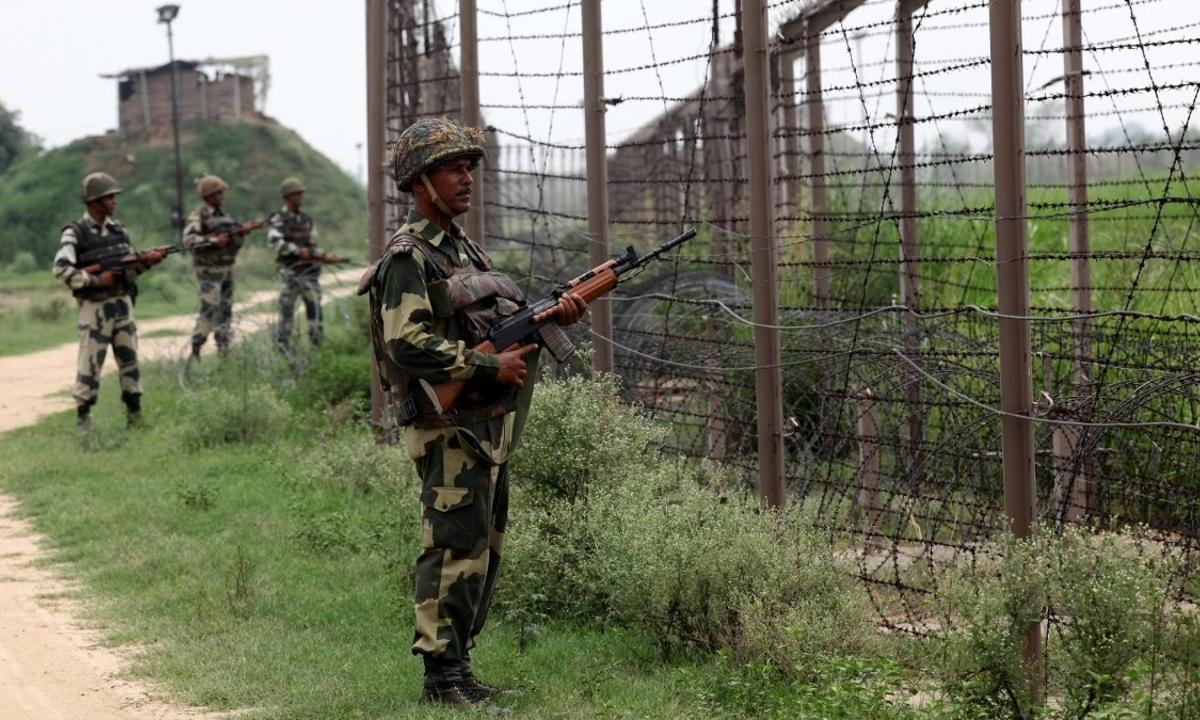 Troops in India's Border Security Force stand guard along fencing near the India-Pakistan Chachwal border in Jammu and Kashmir state. Photo: AFP