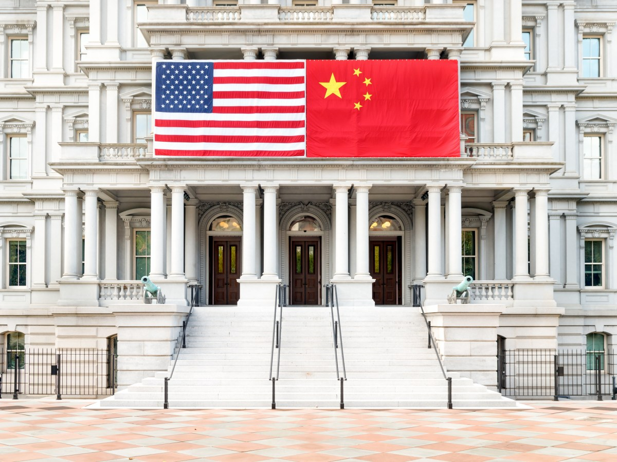 Flags of the United States and China on the Old Executive Office Building in Washington, DC. Photo: iStock