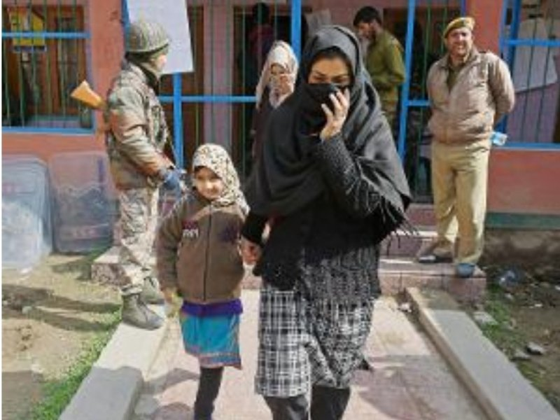 A woman leaves a polling booth after casting her vote in the by-election in Srinagar in April. Photo via Twitter