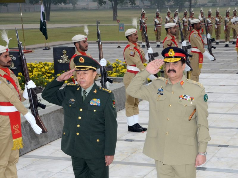 In this handout picture  from the Inter Services Public Relations (ISPR) on November 13, 2015, the vice chairman of China's Central Military Commission, Fan Changlong and Pakistan army head Raheel Sharif (right) salute after laying a wreath at Yadgar-e-Shuhada in Rawalpindi. Photo via AFP