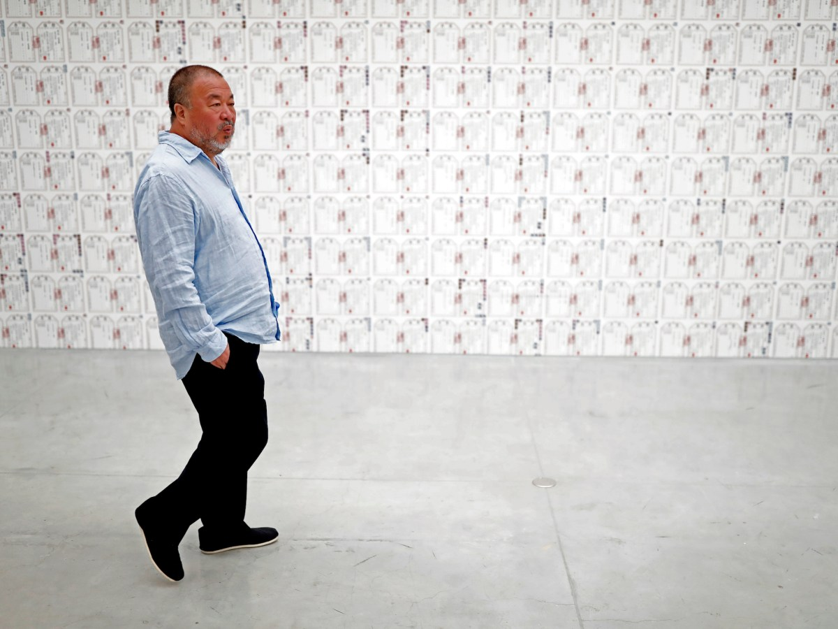 """Chinese artist Ai Weiwei walks at the Israel Museum in Jerusalem on the eve of the opening of his new exhibition """"Maybe, Maybe Not"""" at the Israel Museum in Jerusalem on June 1, 2017.  Photo: Thomas Codex/AFP"""