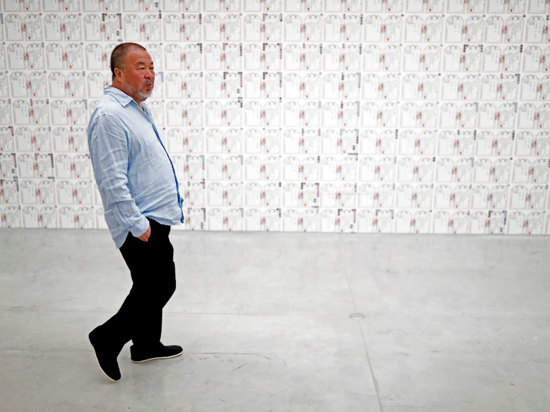 "Chinese artist Ai Weiwei walks at the Israel Museum in Jerusalem on the eve of the opening of his new exhibition ""Maybe, Maybe Not"" at the Israel Museum in Jerusalem on June 1, 2017.  Photo: Thomas Codex/AFP"