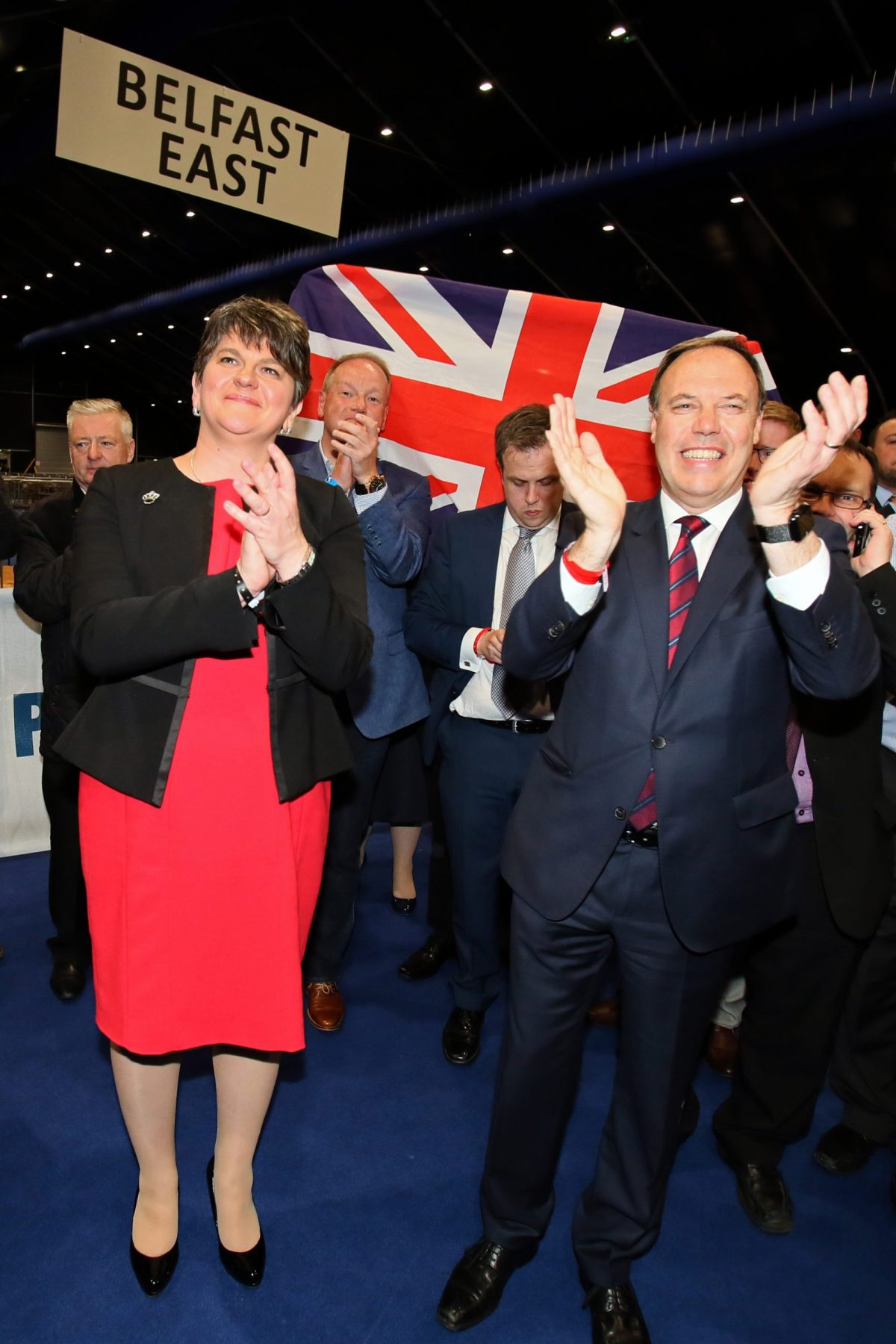 Democratic Unionist Party (DUP) deputy leader Nigel Dodds (right) and leader Arlene Foster celebrate Dodds winning his Belfast North seat at the counting centre in Belfast, Northern Ireland, early in the morning of June 9, 2017. Photo: AFP / Paul Faith