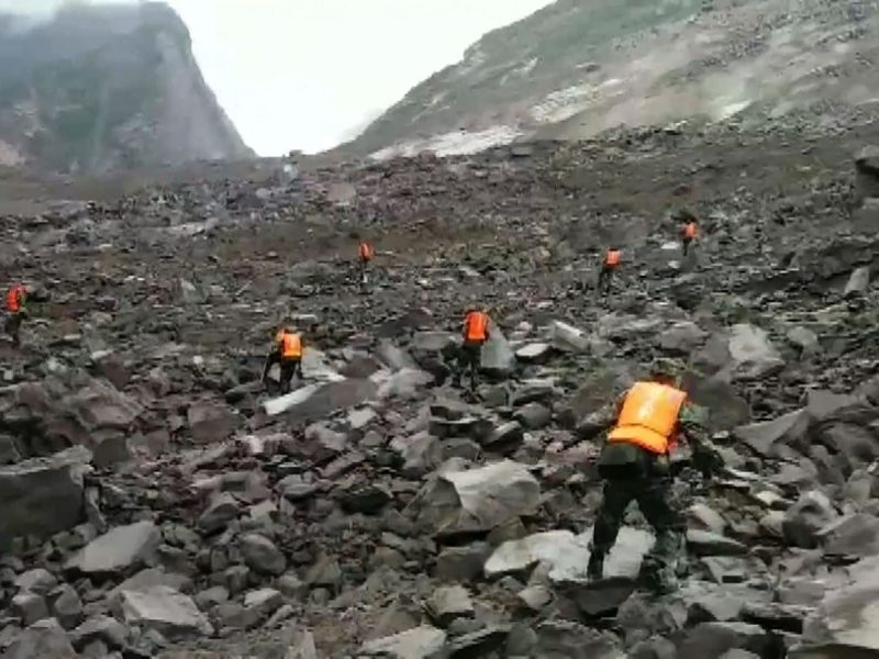 A screengrab taken from a broadcast by China's  CCTV on June 24, 2017 shows rescuers looking for survivors after a landslide hit the village of Xinmo. Photo: AFP / CCTV