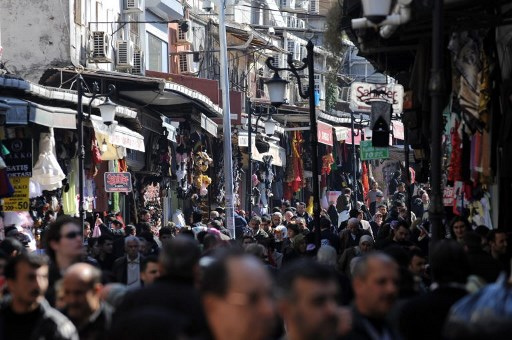 Turkish people throng a street of the Mahmutpasa marketplace in Istanbul. Photo: AFP/Mustafa Ozer