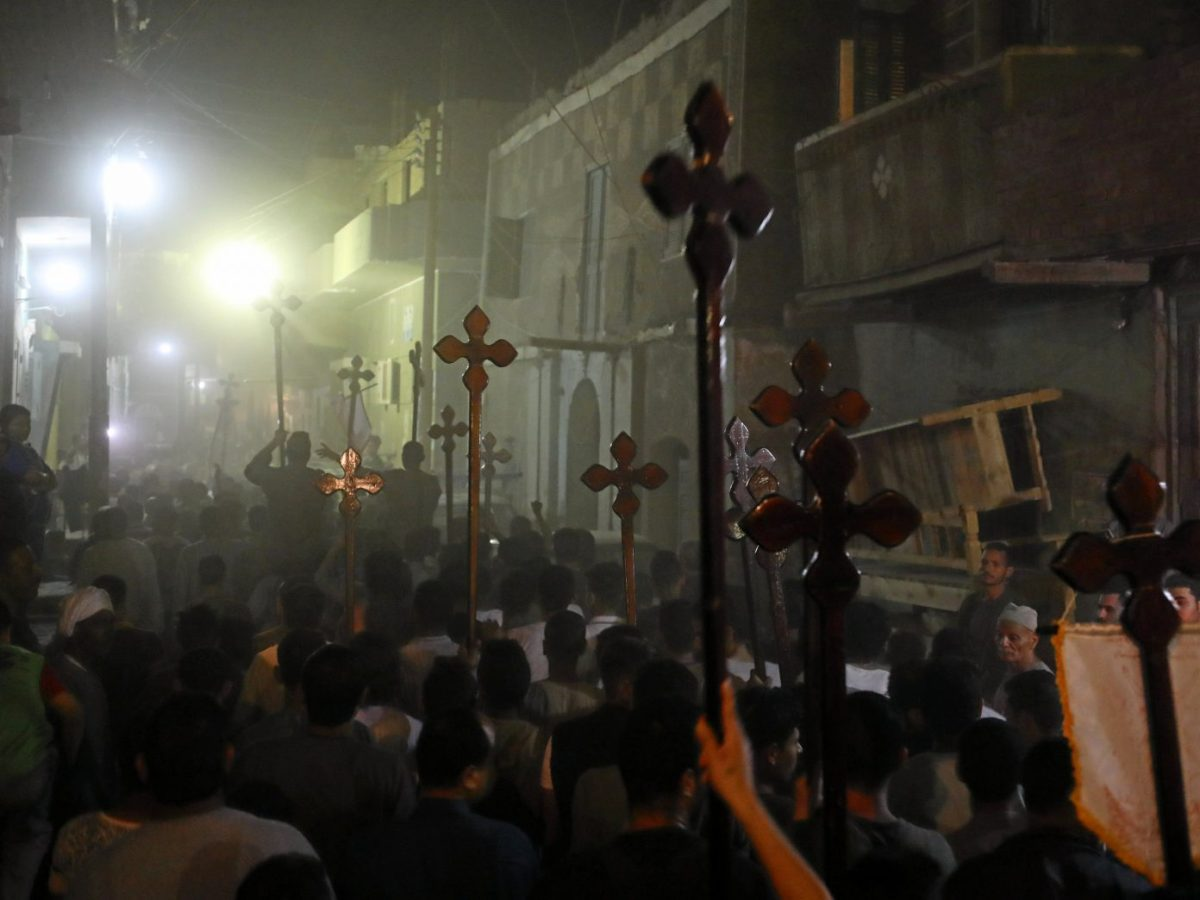 Cross-carrying mourners march after the funeral of Coptic Christians who were killed in Minya, Egypt, on May 26. Photo: Mohamed Abd El Ghany/Reuters