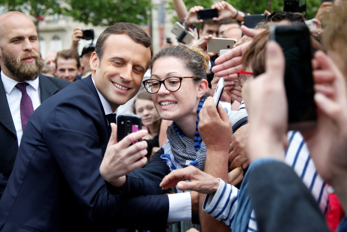 French President Emmanuel Macron poses for a selfie after a ceremony at the Arc de Triomphe in Paris, France, June 3, 2017. REUTERS/Charles Platiau