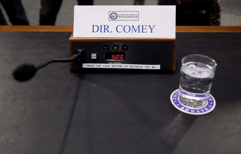 "A microphone and glass of water stand ready for FBI Director James Comey before a Senate Intelligence Committee hearing on ""Russia's intelligence activities.""      Photo: Reuters/Joshua Roberts"