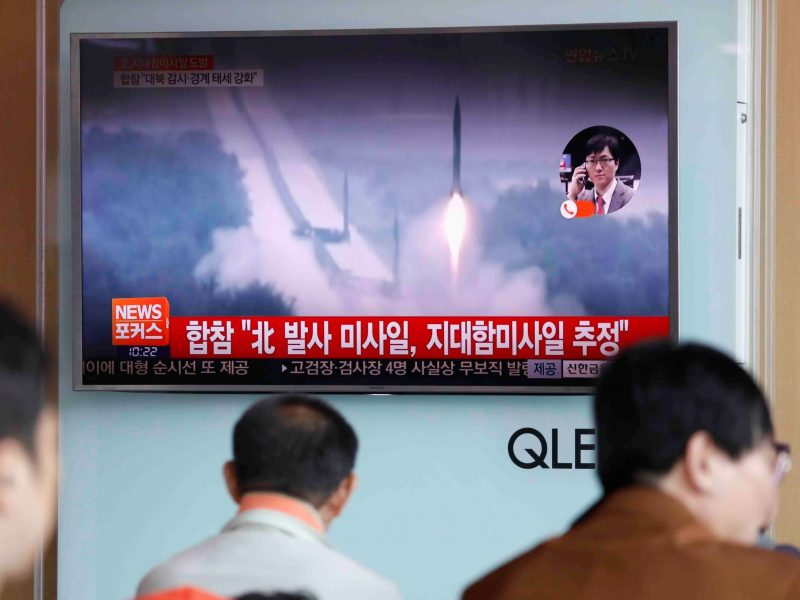 People watch a news report on North Korea firing several land-to-ship missiles off its east coast, at a railway station in Seoul.  Reuters/Kim Hong-Ji