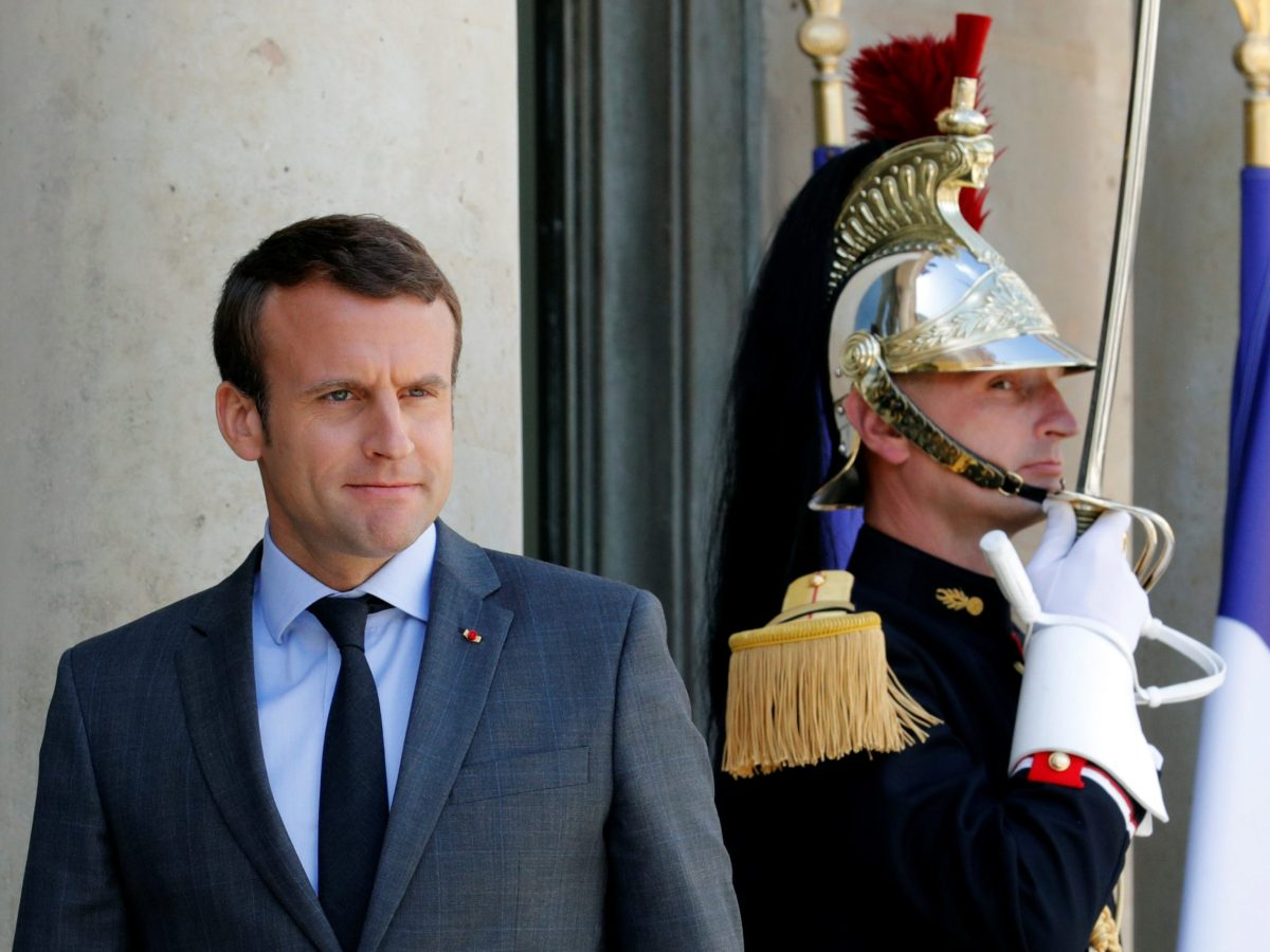 French President Emmanuel Macron waits for guests to leave at the Elysee Palace in Paris. Photo: Reuters / Philippe Wojazer