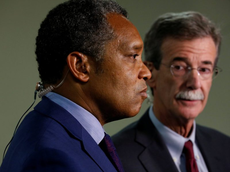 District of Columbia Attorney General Karl Racine and Maryland Attorney General Brian Frosh conduct a live television interview after announcing their lawsuit against US President Donald Trump.  Photo: Reuters/Jonathan Ernst