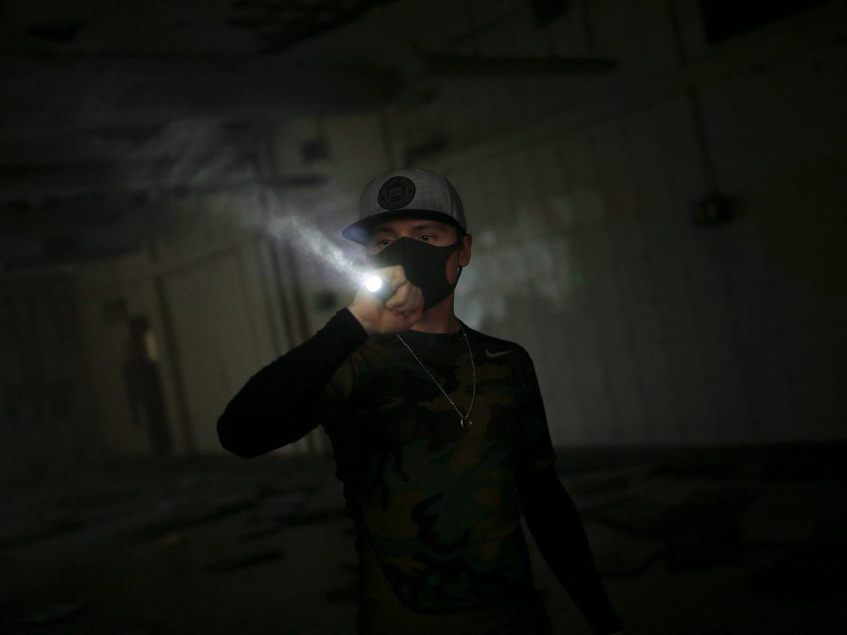 In the dark: A HK URBEX member walks through an abandoned British army barracks in Hong Kong. Photo: Reuters/Tyrone Siu