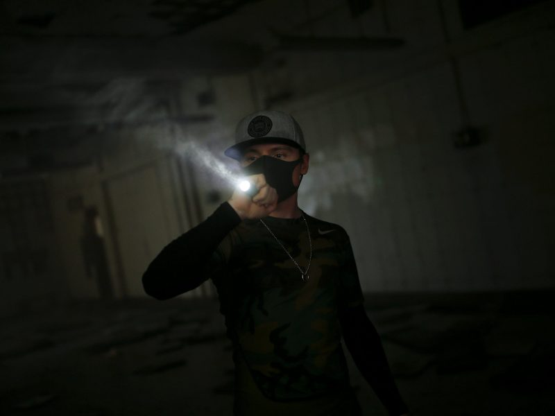 In the dark: A HK URBEX member walks through an abandoned British army barracks in Hong Kong. Photo: Reuters/Tyrone Siu