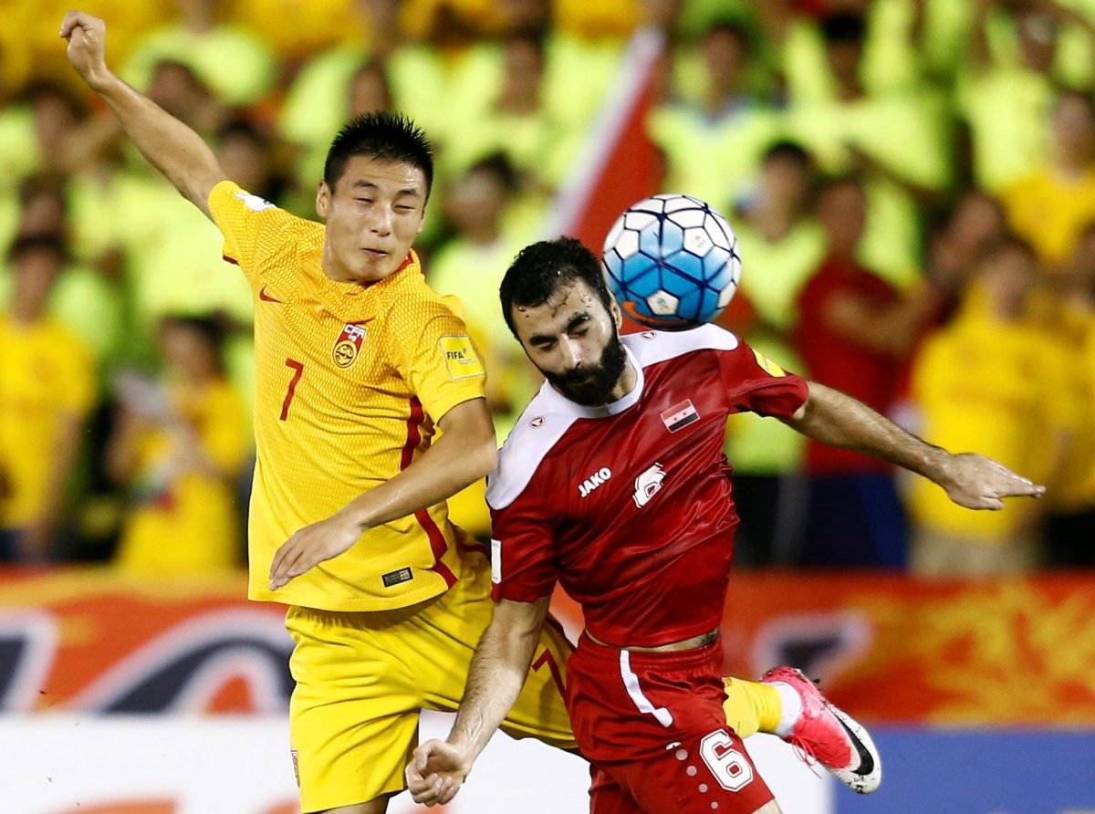 China's Wu Lei in action against Syria's Amro Jeniat in their World Cup qualifying match. Photo: Reuters/Lai Seng Sin