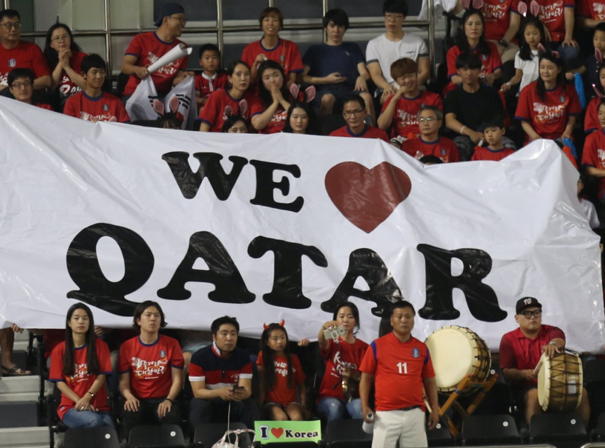 Fans watch a World Cup qualifying match, in Doha, between Qatar and South Korea, in June. Photo: Reuters / Ibraheem Al Omari