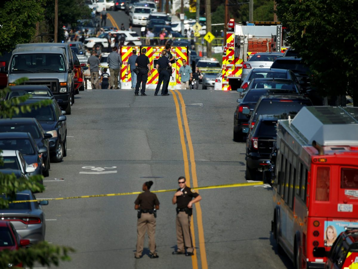 Police officers at a shooting scene after a gunman opened fire on Republican members of Congress during a baseball practice near Washington in Alexandria, Virginia. Photo: Reuters/Joshua Roberts