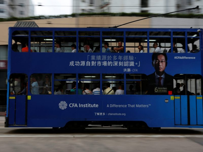 A bus with an advertisement of CFA Institute, featuring Hao Hong, head of research at Bocom International, drives past in Hong Kong, China October 6, 2016. Picture taken October 6, 2016.  REUTERS/Bobby Yip