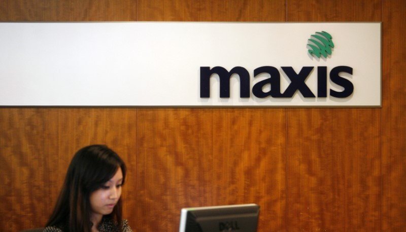 A Maxis logo is on display behind a counter at its headquarters in Kuala Lumpur. Photo: Reuters/Bazuki Muhammad