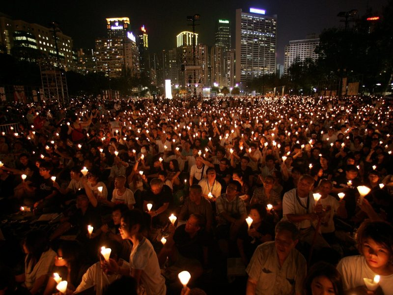Activists hold a candlelight vigil at Hong Kong's Victoria Park on June 4, 2009, to mark the 20th anniversary of the crackdown on the pro-democracy movement in Beijing's Tiananmen Square in 1989. Cradling candles, laying wreaths and clad in black or white, Hong Kong residents transformed a downtown park into a speckled sea of flickering lights, in remembrance of the hundreds of pro-democracy demonstrators and students crushed by tanks and troops near the square two decades ago. Photo: Reuters/Aaron Tam