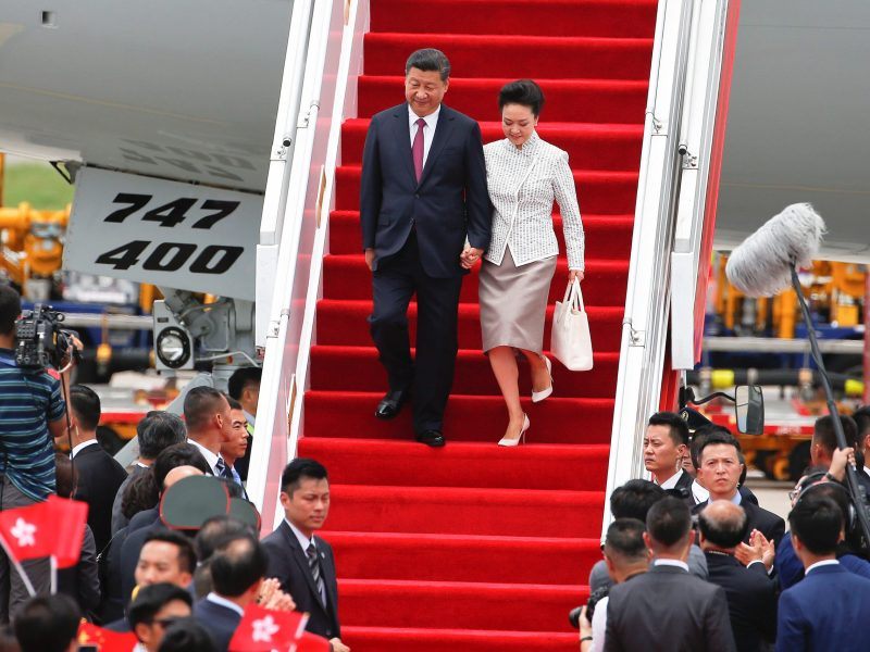 Chinese President Xi Jinping and his wife Peng Liyuan arrive at the airport in Hong Kong, China, ahead of celebrations marking the city's handover from British to Chinese rule, June 29, 2017. REUTERS/Bobby Yip