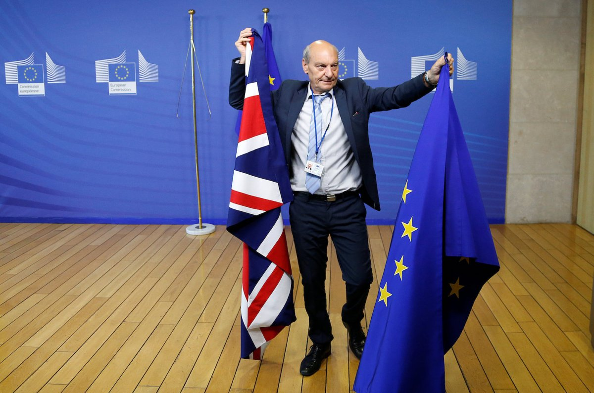 Flags are arranged at the EU headquarters in Brussels as the UK and the European Union launch Brexit talks on June 19, 2017. Photo: Reuters/Francois Lenoir
