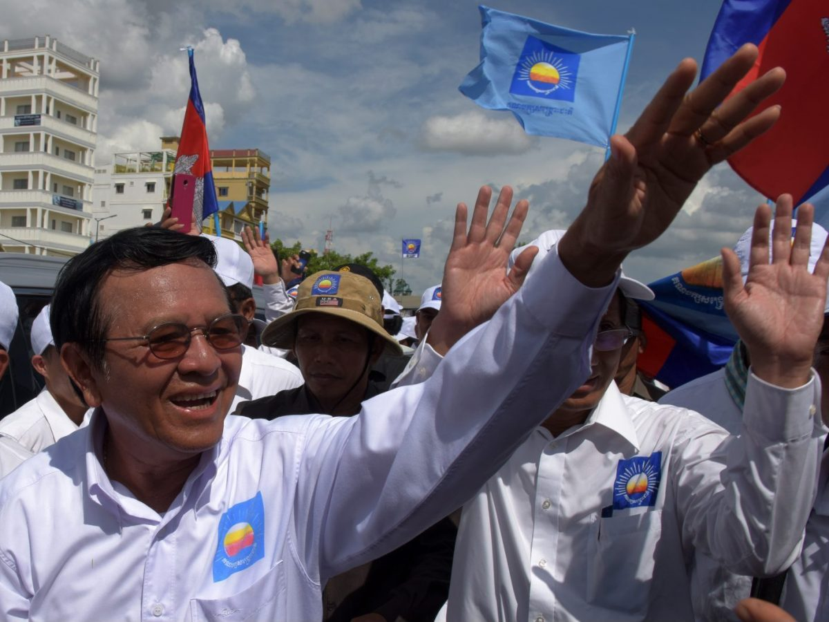 Kem Sokha (L), leader of Cambodia National Rescue Party (CNRP) greets supporters in a rally on the last day of the commune election campaign in Phnom Penh on June 2, 2017.A sea of pro-government supporters rallied in the Cambodian capital in support of strongman PM Hun Sen on June 2, two days before local polls set to test the mettle of an opposition desperate to upend his 32-year rule. / AFP PHOTO / TANG CHHIN SOTHY