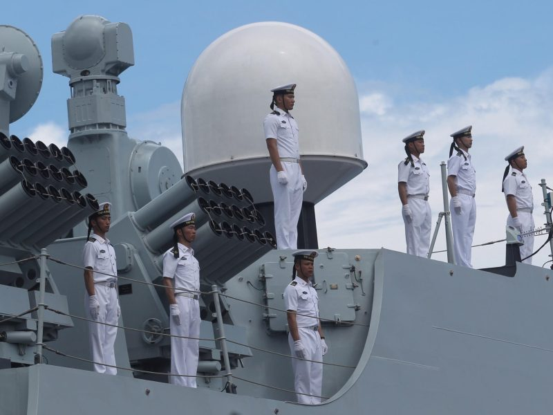 Chinese sailors stand at attention aboard a Chinese naval ship. Photo: Reuters / Lean Daval Jr