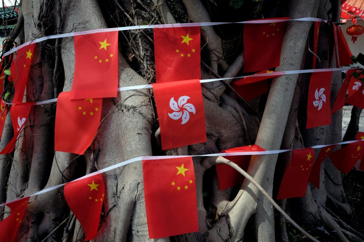 Chinese and Hong Kong flags. Photo: Reuters