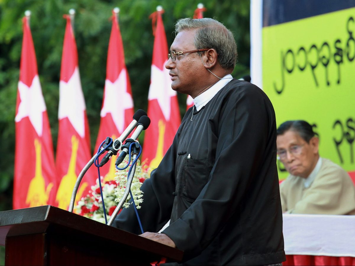 This photograph taken on November 10, 2013 shows Muslim lawyer Ko Ni delivering a public address on amending Myanmar's 2008 constitution, as senior National League for Democracy (NLD) party patron Tin Oo (R) listens, in Yangon. Thousands of mourners gathered on January 30, 2017 to bury Ko Ni, a top Muslim lawyer and adviser to Aung San Suu Kyi, who was gunned down outside Yangon airport in what the ruling party called a political assassination. / AFP PHOTO / Hong Sar