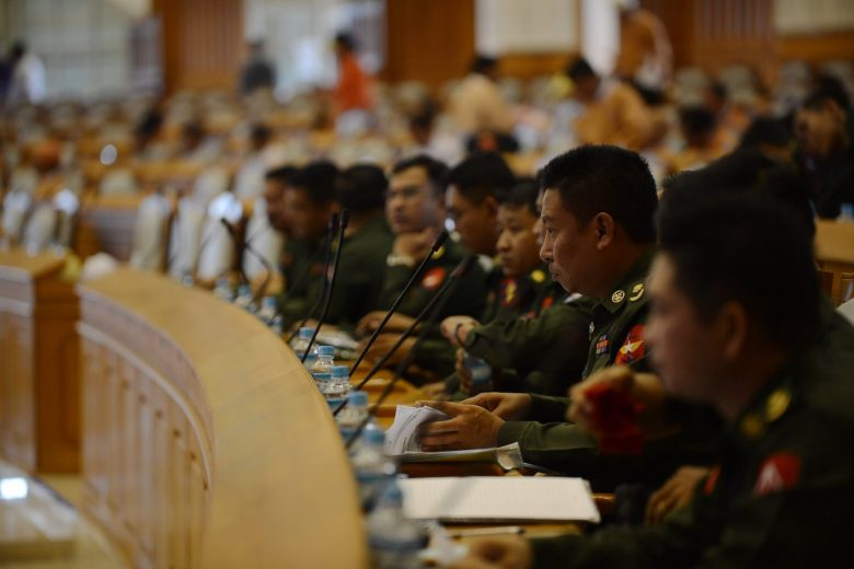 Military members of parliament sit in the parliament for the historic presidential vote on March 15, 2016Myanmar's parliament will hold a historic presidential vote on March 15 expected to confirm that Htin Kyaw, a respected writer and longtime close friend of Suu Kyi will be the former junta-run nation's first civilian leader in decades. / AFP PHOTO / ROMEO GACAD