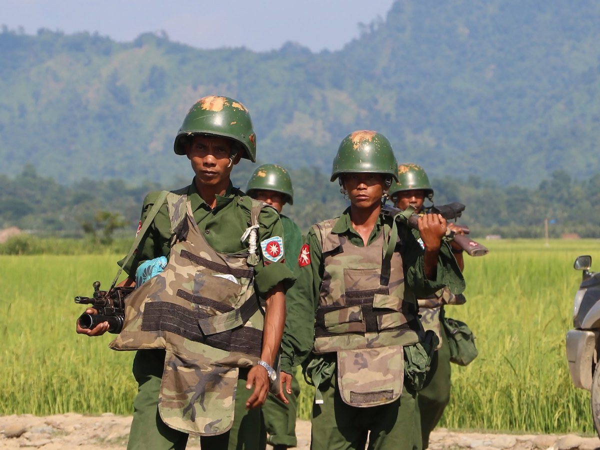 In this photograph taken on October 21, 2016, armed Myanmar soldiers patrol a village in Maungdaw located in Rakhine State as security operation continue following the October 9, 2016 attacks by armed militant Muslim. The United Nations called for an investigation into claims Myanmar troops have been killing civilians and torching villages in northern Rakhine, as reports emerged thousands of Rohingya had been forced from their homes. / AFP PHOTO / STR