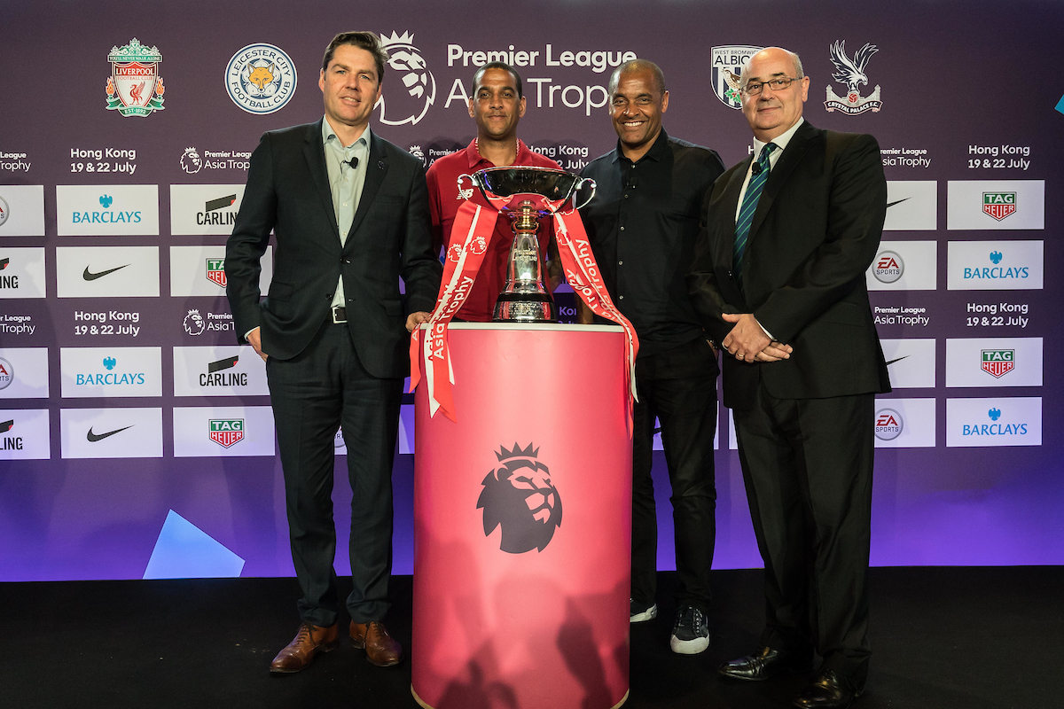From left to right: Richard Masters, Phil Babb, Mark Bright, and Mark Sutcliffe pose in front of the Premier League Asia Trophy in Hong Kong. Photo: Chris Wong / Power Sport Images