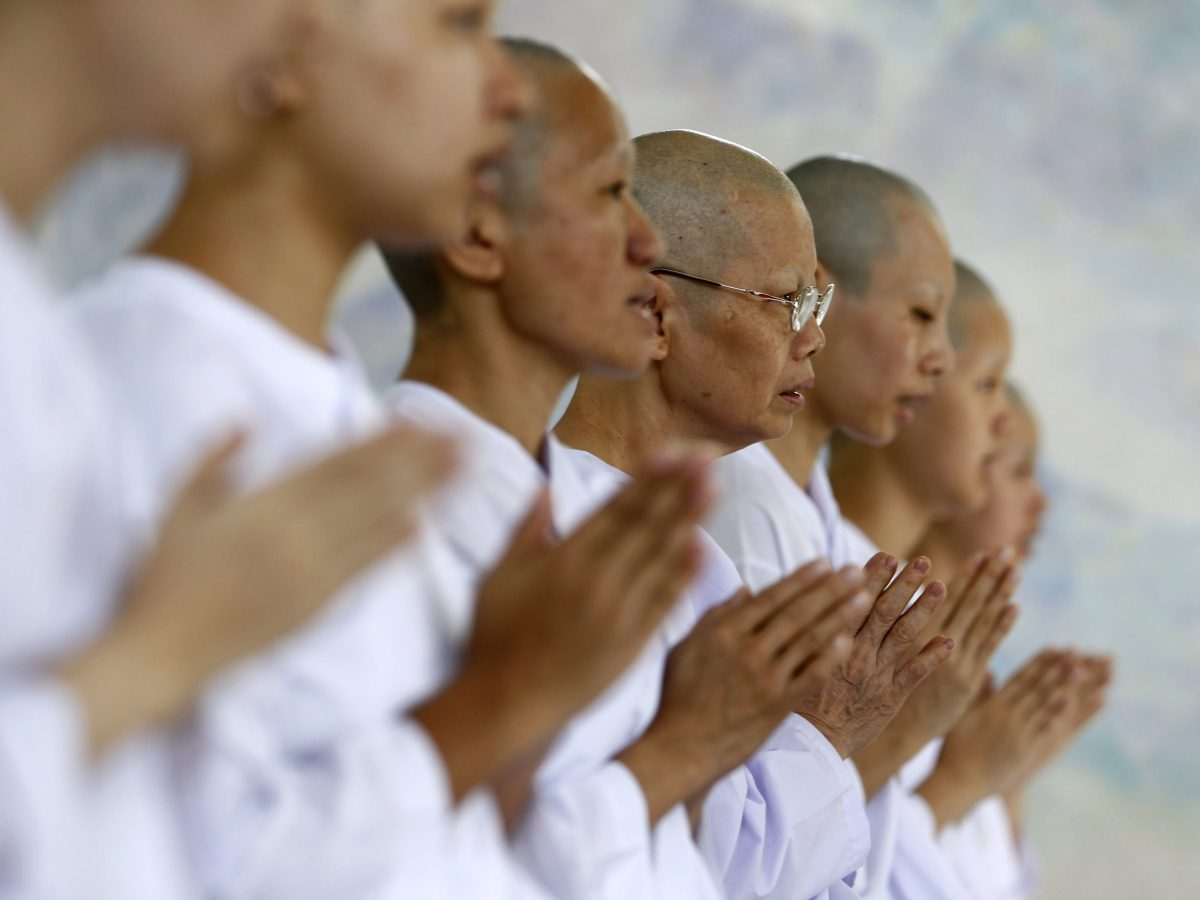 Buddhist nuns chant in the Sathira-Dhammasathan Buddhist meditation center in Bangkok. Photo: Reuters/Sukree Sukplang