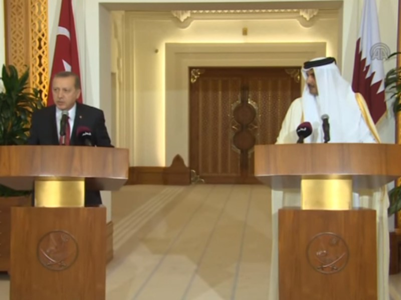 Turkish President Recep Erdogan and Qatar's Emir Sheikh Tamim bin Hamad Al Thani hold a press conference in Doha, Qatar on December 02, 2015.  Source: Youtube screen grab of footage by Stringer / Anadolu Agency