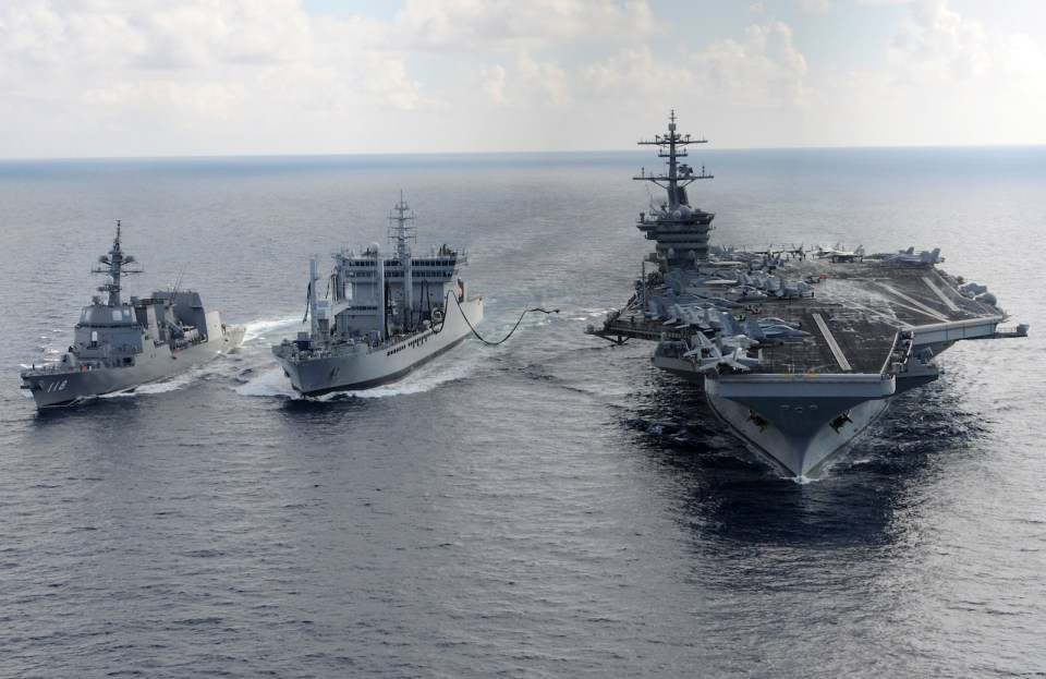 "Aircraft carrier USS Theodore Roosevelt (CVN 71) and Japanese Maritime Self-defense Force Akizuki-class destroyer JS Fuyuzuki (DD-118)(L) transit alongside the Indian Deepak-class fleet tanker INS Shakti (A 57)(C) during a replenishment-at-sea exercise as a part of Exercise Malabar 2015. Malabar is a continuing series of complex, high-end war fighting exercises conducted to advance multi-national maritime relationships and mutual security.  AFP PHOTO / HANDOUT  / US NAVY / MCS CHAD M. TRUDEAU           == RESTRICTED TO EDITORIAL USE / MANDATORY CREDIT: ""AFP PHOTO / HANDOUT / US NAVY / MCS CHAD M. TRUDEAU  ""/ NO MARKETING / NO ADVERTISING CAMPAIGNS / DISTRIBUTED AS A SERVICE TO CLIENTS == / AFP PHOTO / US NAVY / MCS CHAD M. TRUDEAU"